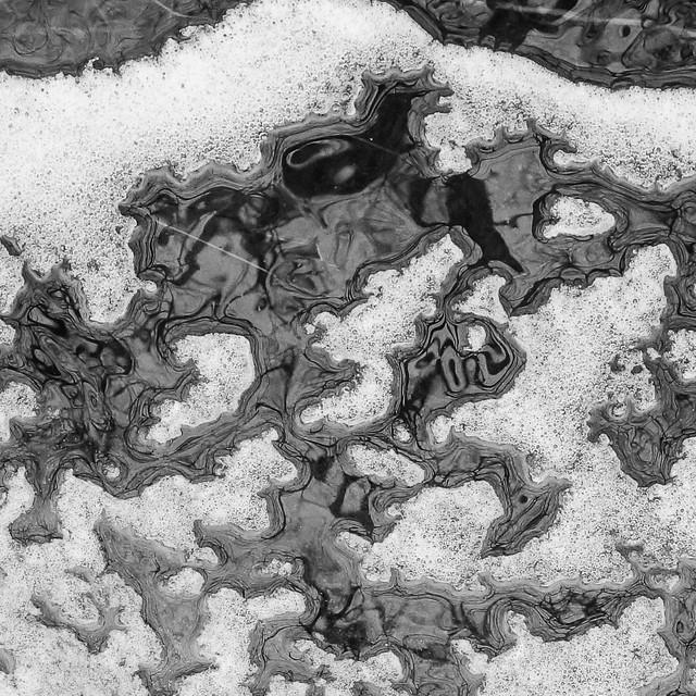 Ice, frozen foam, reflection in upper Pine Swamp