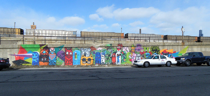 Colourful creatures mural and coal train