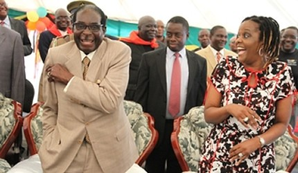 Republic of Zimbabwe President Robert Mugabe with First Lady Amai at a ZANU-PF rally in preparation for the upcoming national elections inside the country. Mugabe is committed to peaceful elections in the Southern African state. by Pan-African News Wire File Photos