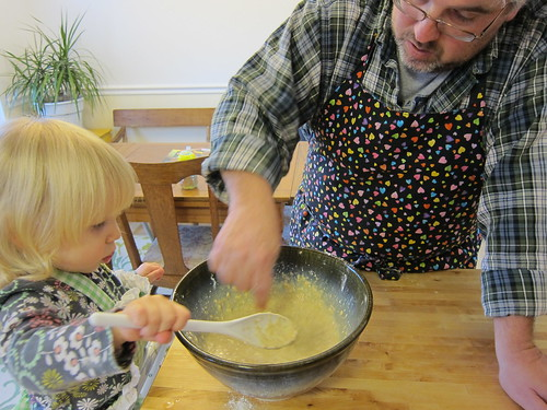 Wet ingredients have been added now Dad helps Momo with mixing