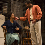 Keona Welch ('Beneatha Younger') and Jason Bowen ('Joseph Asagai') in the Huntington Theatre Company's production of Lorraine Hansberry's A RAISIN IN THE SUN. Mar. 8 - Apr. 7, 2013 at Avenue of the Arts / BU Theatre. huntingtontheatre.org. photo: T. Charles Erickson
