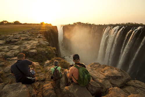 africa travel sunset people water waterfall sitting view tourist sit zimbabwe victoriafalls seated photographyforrecreation photographyforrecreationeliteclub