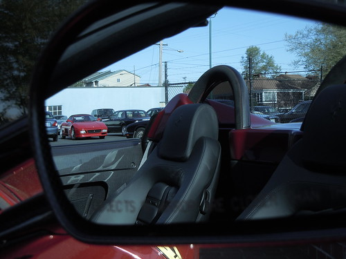 1994 Ferrari 348 Spider in mirror of 2009 Ferrari 430 Scuderia Spider 16M.