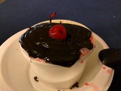 Vanilla ice cream with chocolate fudge and cherry from the ice cream party