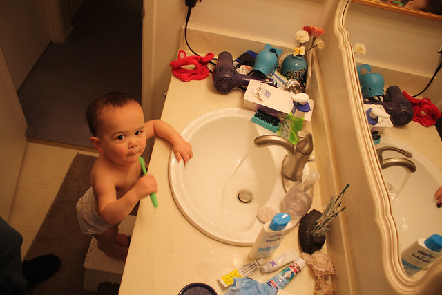Brushing teeth by himself, stool