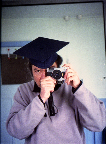reflected self-portrait with Fujica D1 camera and mortar board by pho-Tony