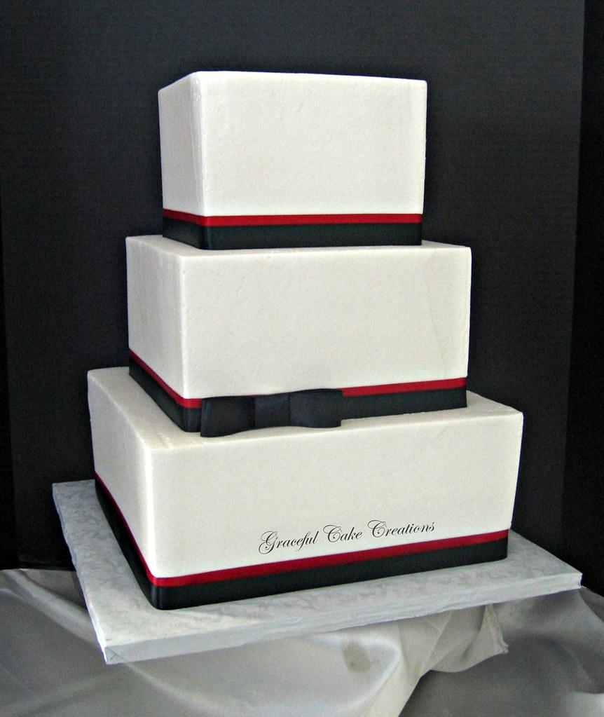 Elegant Square White Black And Red Wedding Cake