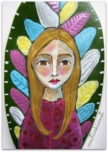 girlw/feathers magnolia leaf