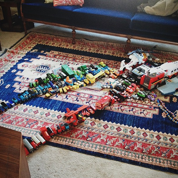 Well that's a fun surprise. Every vehicular toy they own, by color. #butwhoeollcleanitup ?#vscocam
