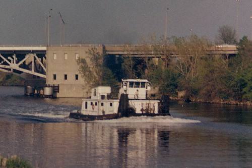A river towboat heads west on the Chicago Sanitary and Ship Canal.  Summit / Lyons Illinois.  May 1989. by Eddie from Chicago
