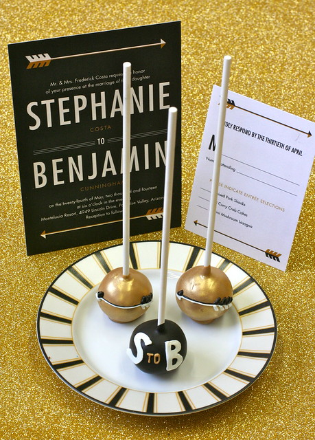 Black and gold cake pops with lettering detail and arrow theme to match Wedding Paper Divas' Invitation Suite