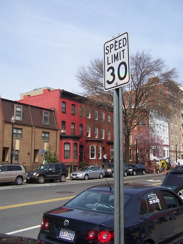 30 mph speed limit sign posted on 11th Street NW