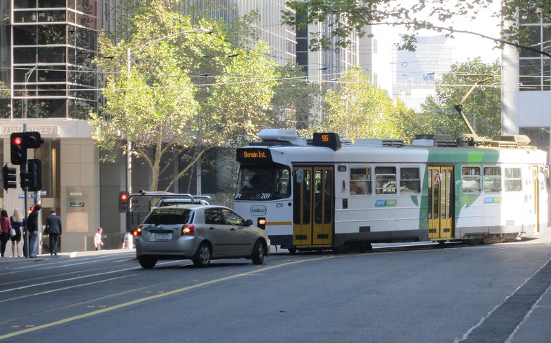 Friday lunchtime: eastbound tram meets westbound car in Flinders Lane