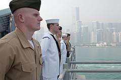 Sailors and Marines aboard amphibious assault ship USS Peleliu (LHA 5) man the rails as the ship arrives in Hong Kong, April 15. (U.S. Navy photo by Mass Communication Specialist 3rd Class Jasmine Sheard)