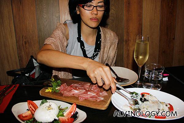 Rachel portioning the antipesti (appetiser)