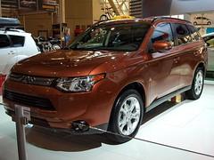 automobile(1.0), automotive exterior(1.0), sport utility vehicle(1.0), vehicle(1.0), compact sport utility vehicle(1.0), mitsubishi outlander(1.0), mitsubishi(1.0), bumper(1.0), land vehicle(1.0),
