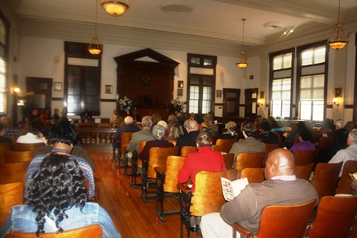 The inside of the newly restored courthouse and the attendees at the Grand Opening Ceremony. USDA photos.