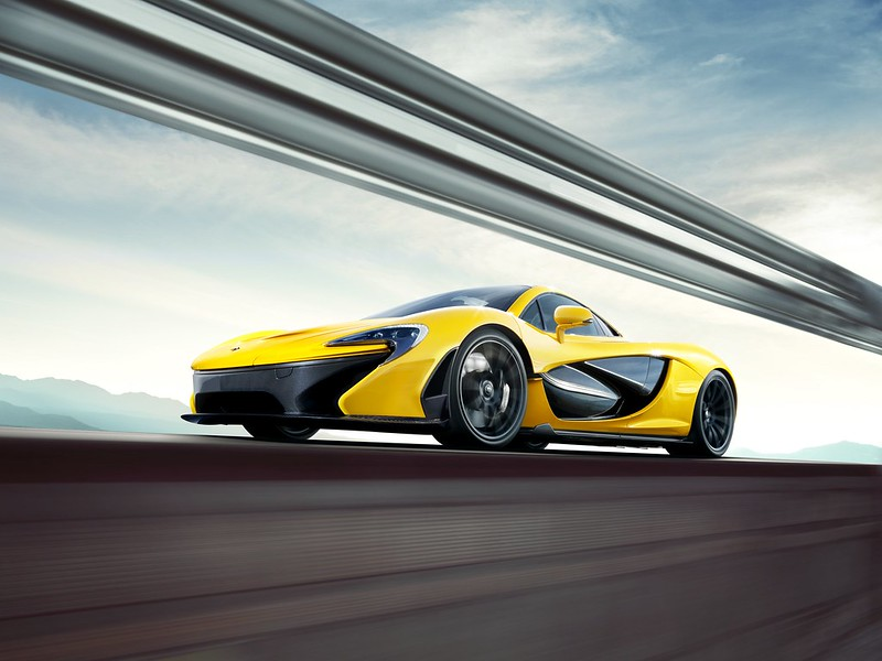 McLaren P1 Yellow Geneva motion side