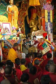 Sakya Lamdre, Dagchen Rinpoche's grandson, young Prince - Lama HE Avikritar Rinpoche offers a full Tibetan Buddhst mandala, while lamas, monks, videographers and photographers look on, Tharlam Monastery, Boudha, Kathmandu, Nepal
