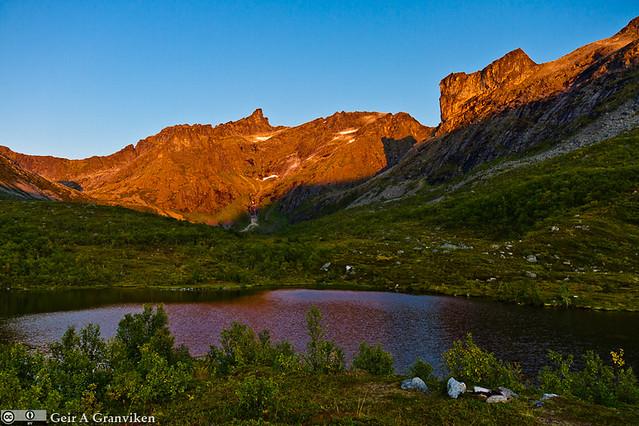 Hellig fjell. Holy Mountain Finnkjerka, Troms. Sunset over Kvaløya, Troms