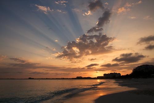 ocean morning sun beach clouds sunrise island warm day resort tropical sunburst rays turkscaicos turksandcaicos gracebay pwpartlycloudy
