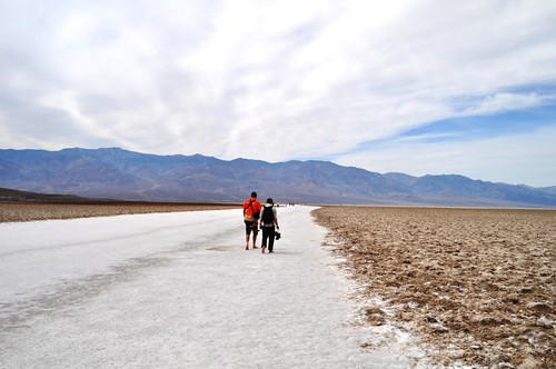 A Couple Walks Barefoot through Badwater Basin, Death Valley National Park, Calif.