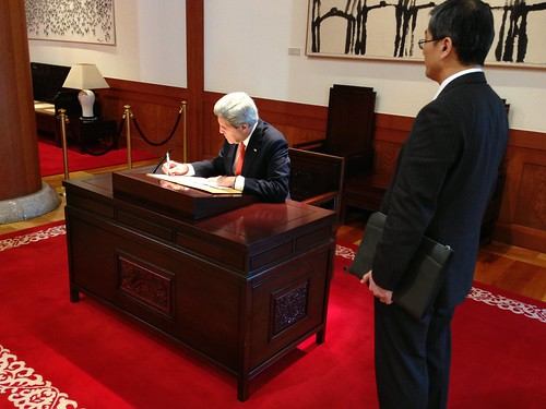 Secretary Kerry Signs Guest Book by U.S. Department of State