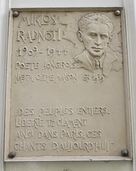 Photo of Miklos Radnoti white plaque