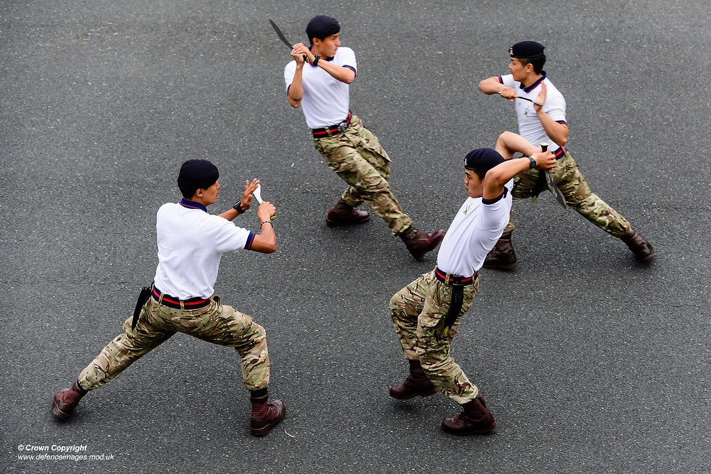 The Queen's Gurkha Signals Dancers perform a highly skilled routine.