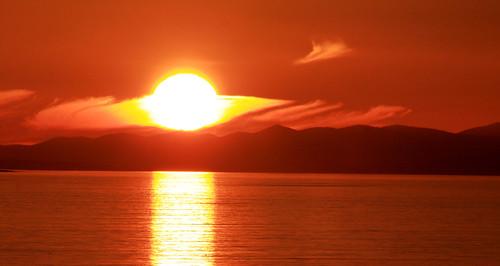 light sunset sky orange sun mountains sunrise coast moray firth louds gazasal