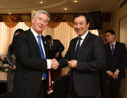 UK's Minister for Business and Enterprise Michael Fallon (left) handshakes with Nurlan Sauranbayev, Deputy Minister for Industry and New Technologies, 18 February 2013, Astana