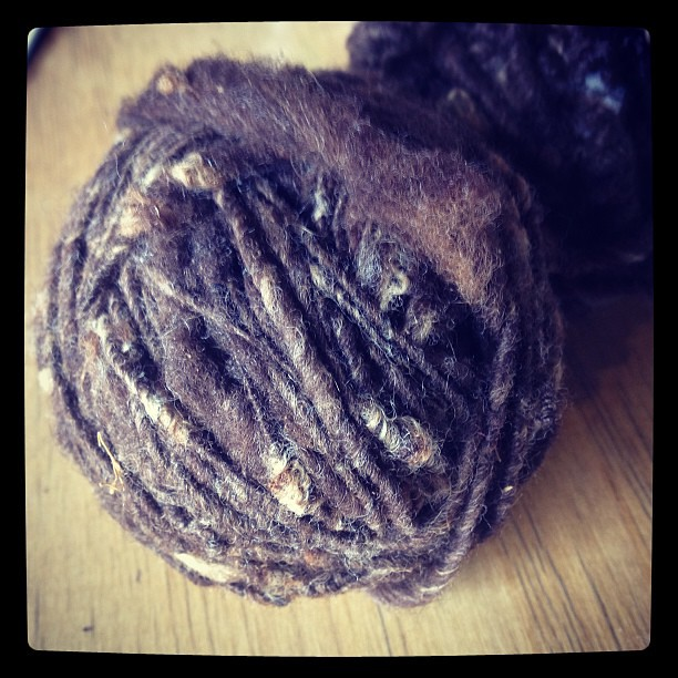 My first-ever knitting student, now 13 yrs old, brought me llama yarn she spun after borrowing my carder. #awesome