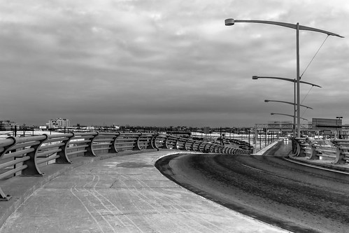 road street sky bw cloud canada lamp monochrome car airport ramp quebec montreal railing departure dorval pierreelliotttrudeau canoneos7d 2470lii
