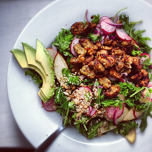 Kale salad with apples, tempeh, toasted seeds and ... shocker ... avocado.