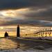 Winter Pier and Lighthouse Light by matthewkaz