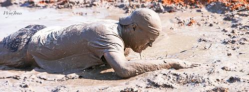 man texas mud houston tshirt cap shorts runner crawl obstacle muddy dripping ballcap mudrun mudhole northhouston samhoustonracepark wyojones mightymuddash