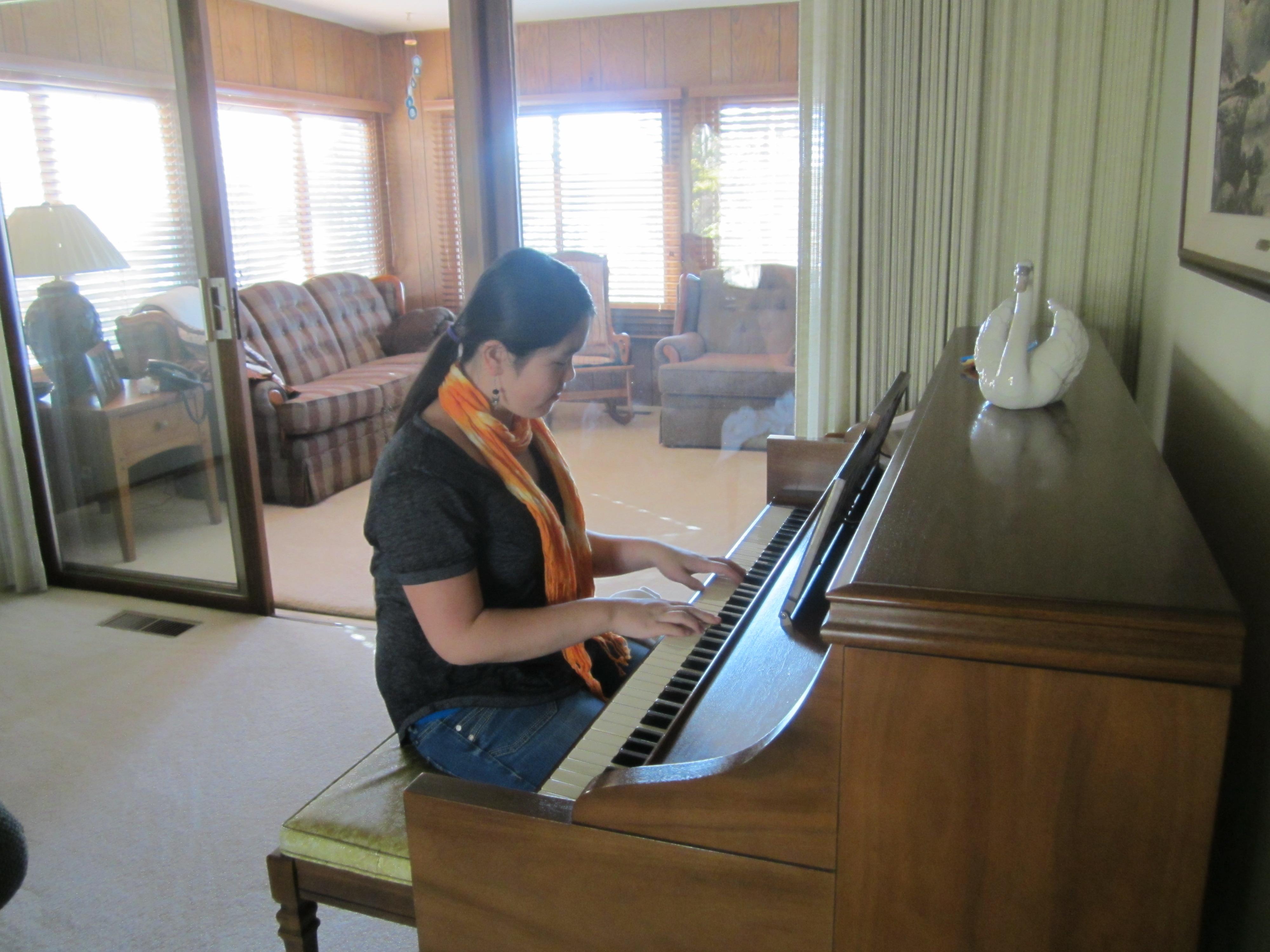 Sophia Playing the Piano for Nana