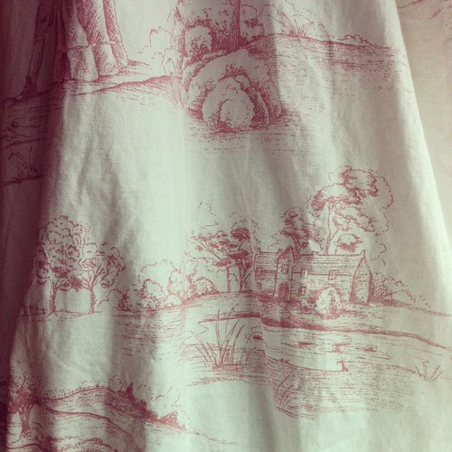 Mauve and cream toile curtains in LB's bedroom.