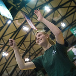 13-021 -- Ilene Gorski '13 conducts the Titan Band in the Shirk Center during a men's basketball game against Augustana.