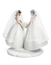 two women on a wedding cake topper
