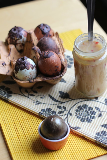 Golden chocolate eggs filled with candied bacon salted caramel