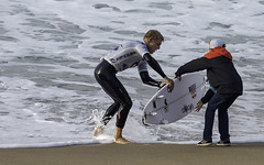 Mick Fanning grabs a new board from his caddy during his quarter final loss to eventual champion Adriano de Souza.