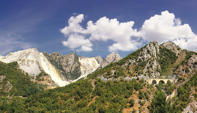 Travelling along winding and steep roads of the marble mountains