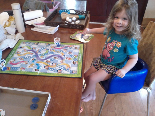 Our first time playing Chutes & Ladders, and she won!