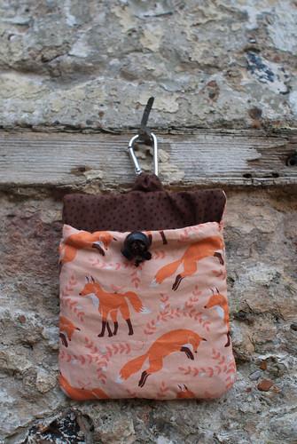 A hand sewn dog treat bag