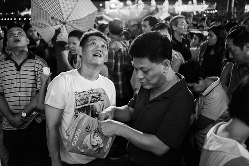 A man checking his loot while his friend looks skywards for glimpses of additional gold dust from heaven.