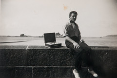 Doug with hired radio on Jersey seafront 1956