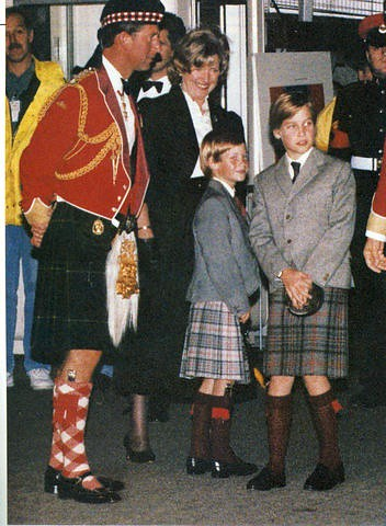1989 with their father in Scottish dress