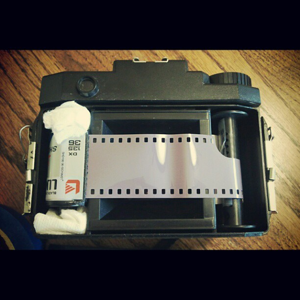 Shooting 35mm film in my #holga120. Loaded cartridge, jammed paper towel on the ends, and taped film leader to the take up roll. 34 clicks on the winder to advance the film. Pictures when I'm done! #filmisnotdead
