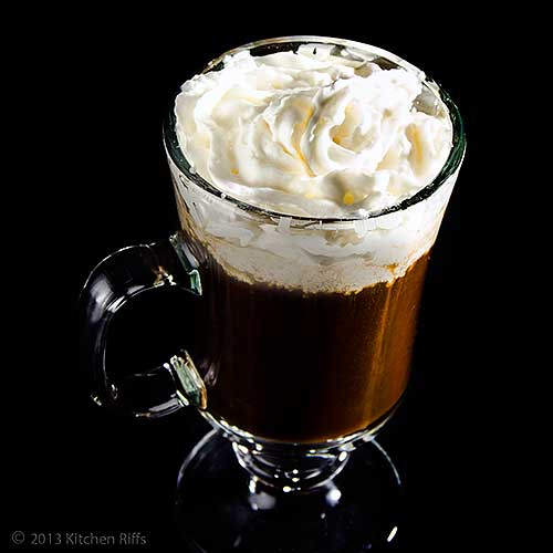Irish Coffee with Whipped Cream Garnish in Glass Irish Coffee Mug